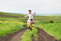 Happy girl running on a countryside road Royalty Free Stock Photography