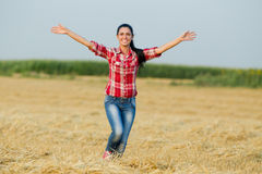Happy girl running in the field Royalty Free Stock Photography