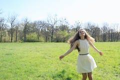 Happy girl running on meadow Stock Photo