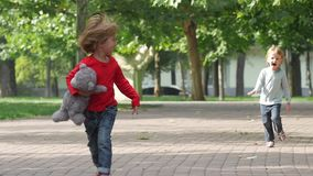 Happy girl running it park with her sister stock footage