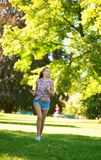 Happy girl running in park Royalty Free Stock Photo