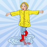 Happy Girl Running in Puddles after Rain Royalty Free Stock Images