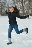 Happy Girl Running in Snow Royalty Free Stock Image