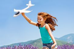 Happy girl running with toy plane outdoors Stock Photography