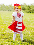Happy girl in russian traditional folk clothes Stock Photography