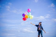 Happy girl`s hold ball color on the nice day and sky backgrund royalty free stock image