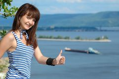 Happy girl in sailor's striped vest stock images