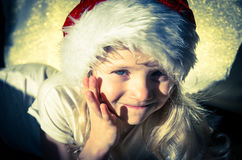 Happy girl with santa claus cap Royalty Free Stock Images