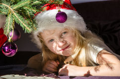 Happy girl with santa claus cap Stock Photography