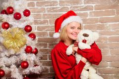 Happy girl in santa claus hat. New year party. delivery christmas gifts. Checking his special list. Smiling woman stock photography