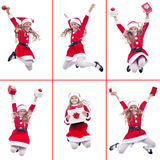 Happy girl with santa costume jumping Stock Photography