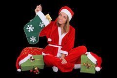 Happy girl in santa costume sitting with presents Royalty Free Stock Photos