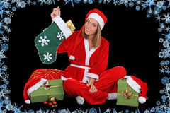Happy girl in santa costume sitting with presents Royalty Free Stock Image