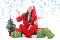 Happy girl in santa costume with snow Stock Images