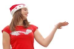 Happy girl in Santa hat stock photography