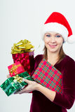 Happy girl in santa hat with gift boxes Royalty Free Stock Photography