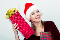 Happy girl in santa hat with gift boxes Stock Photo