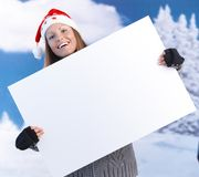 Happy girl in santa hat holding huge letter Stock Image