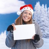 Happy girl in santa hat holding letter in hand Stock Photos