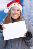 Happy girl in santa hat holding letter in hand Stock Images