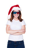 Happy girl in santa hat and stereo glasses Stock Photos