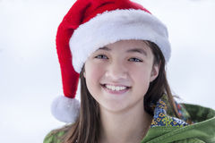 Happy girl in santa hat. Stock Photo