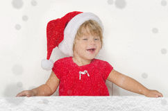 Happy girl in Santa suit with snow Royalty Free Stock Photography