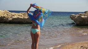 Happy Girl with Scarf Walking on the Summer Beach in Red Sea. Slow Motion stock footage