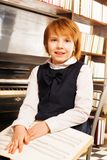 Happy girl in school uniform holding piano notes Royalty Free Stock Photos