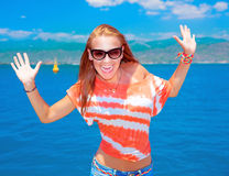 Happy girl screaming with joy. Portrait of happy girl screaming with joy with raised up hands, having fun on the beach, enjoying time spending near sea, crazy Stock Photos