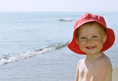 Happy girl by the sea royalty free stock image