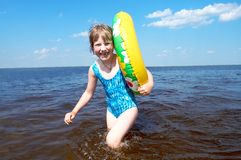 Happy girl at sea stock images