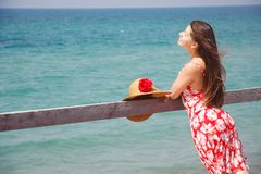 Happy girl on sea background Stock Images
