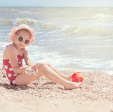 Happy girl at sea beach royalty free stock photography