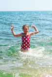 Happy girl at sea beach Royalty Free Stock Images
