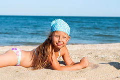 Happy girl at sea beach Stock Images