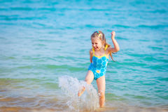 Happy  girl in the sea. Fun with water drops Royalty Free Stock Photo