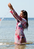Happy girl on the sea in summer Royalty Free Stock Image