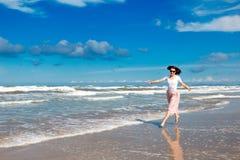 Happy girl on seashore in Rimini stock photo
