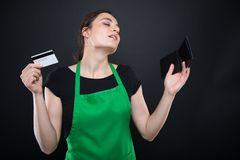 Happy girl seller with debit card Royalty Free Stock Images