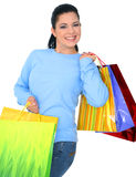 Happy Girl Shopping. Beautiful young woman carrying shopping bags. isolated royalty free stock photos