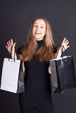 Happy girl with shopping. Studio photography Stock Images