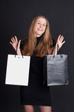 Happy girl with shopping. Studio photography Royalty Free Stock Photo