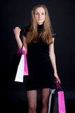 Happy girl with shopping. Studio photography Royalty Free Stock Images