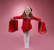 Happy girl with shopping bag. On red background Royalty Free Stock Photo