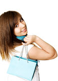 Happy Girl with Shopping Bag. A young girl is holding a shopping bag and smiling at the camera Stock Photography