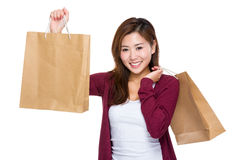 Happy girl with shopping bag. Asian woman isolated on white Royalty Free Stock Photography