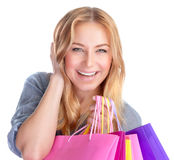 Happy girl with shopping bag. Closeup portrait of beautiful happy girl with colorful shopping bag isolated on white background, season sales concept Stock Photography
