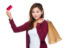 Happy girl with shopping bag and credit card. Asian woman isolated on white Royalty Free Stock Photo