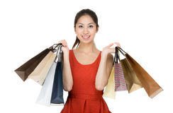 Happy girl with shopping bag. Isolated on white Royalty Free Stock Images